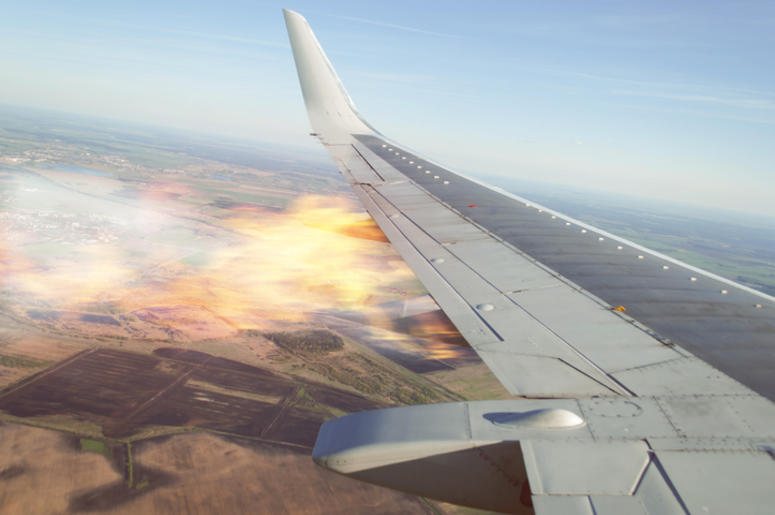 Burning wing of the plane, the plane falling, the view from the window of the aircraft, the emergency situation on Board a passenger liner