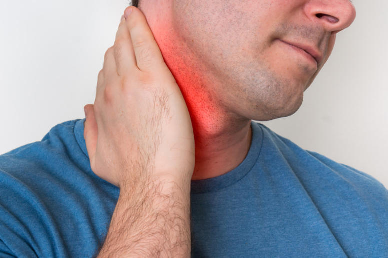 Man with muscle injury having pain in his neck