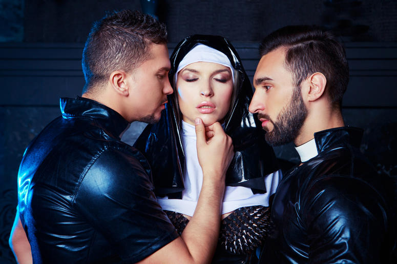 Striptease dancers dressed as a nun and priests. Lash, dance.