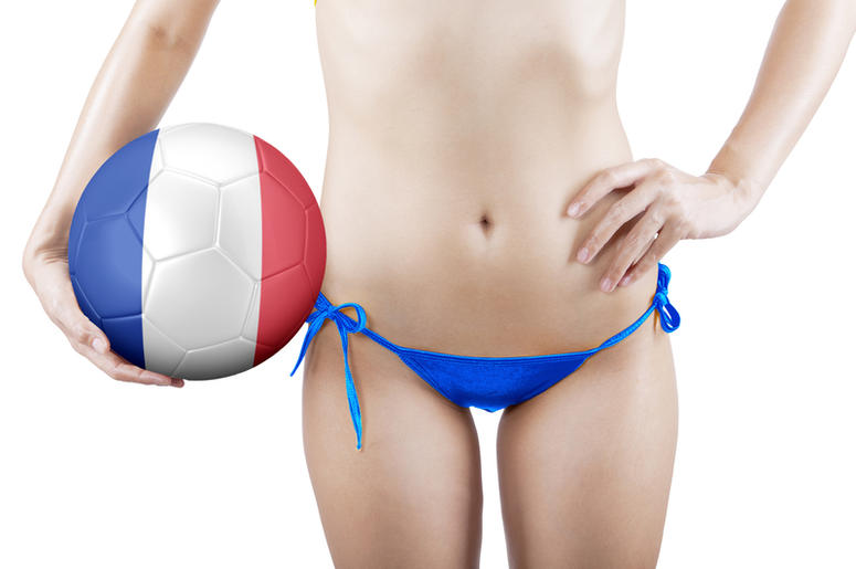 Woman with ball and wearing blue underwear