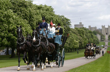 Horse-drawn carriages make their way down the Long Walk from Windsor Castle in Windsor, England, Friday, May 11, 2018.