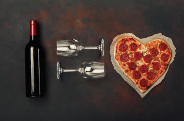 Pizza and wine on a date.