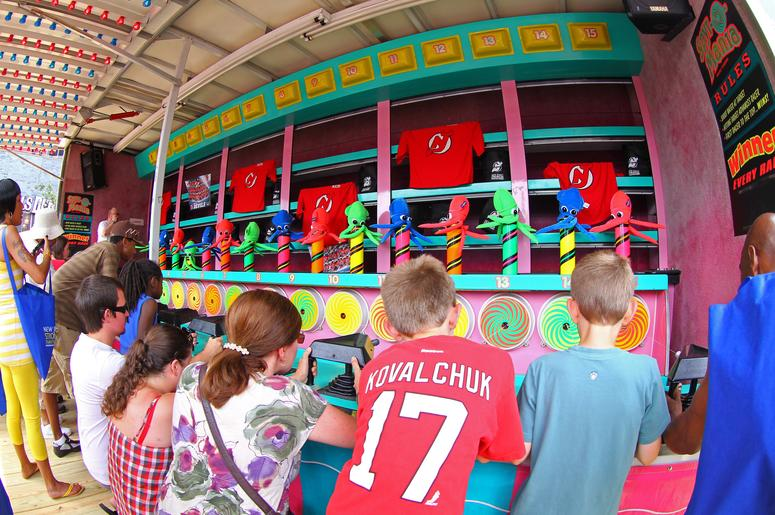 Kids play games at county fair.