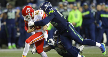 AP source: Chiefs get Clark from Seahawks for draft picks