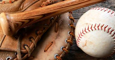 A top view image of an old used baseball, baseball glove, and baseball bat