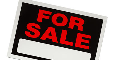 A For Sale sign.