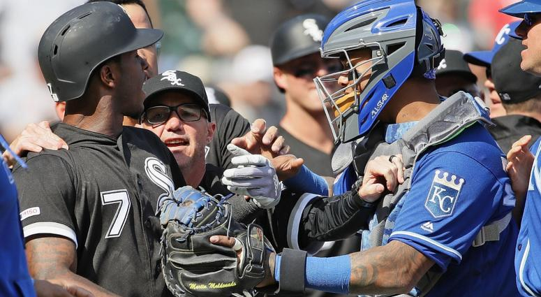 Tim Anderson of the Chicago White Sox argues with the Kansas City Royals after getting hit by a pitch.
