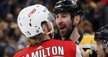 Zdeno Chara of the Boston Bruins and Dougie Hamilton of the Carolina Hurricanes exchange words during Game 1 of their playoff series.