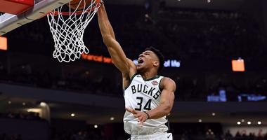Giannis Antetokounmpo of the Milwaukee Bucks dunks during an NBA game in 2019.