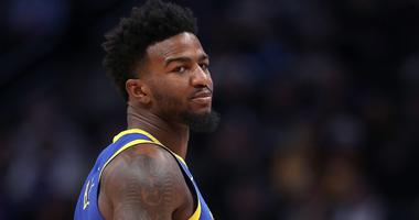 Jordan Bell looks on during a Golden State Warriors game