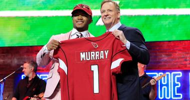Kyler Murray poses on stage with NFL commissioner Roger Goodell after the Arizona Cardinals selected him with the No. 1 pick in the 2019 NFL Draft.