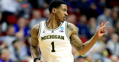 Charles Matthews of Michigan points during a first-round win over Montana in the 2019 NCAA Tournament.