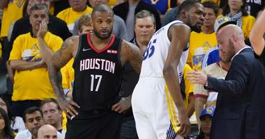 P.J. Tucker of the Houston Rockets watches as Kevin Durant of the Golden State Warriors limps off with a calf injury.