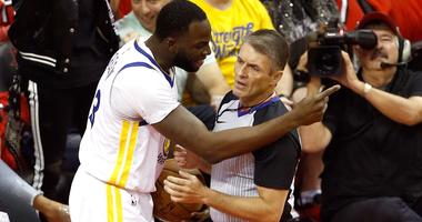 Draymond Green of the Golden State Warriors argues with referee Scott Foster during the 2018 playoffs against the Houston Rockets.