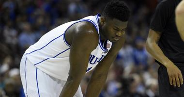 Zion Williamson of Duke rests his hands on his knees during a 2019 NCAA Tournament game against Central Florida.