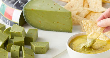 A wedge of green guacamole cheese from Dairy Dairy of Holland