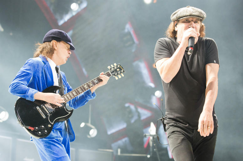 Angus Young (L) and Brian Johnson of AC/DC perform in 2016