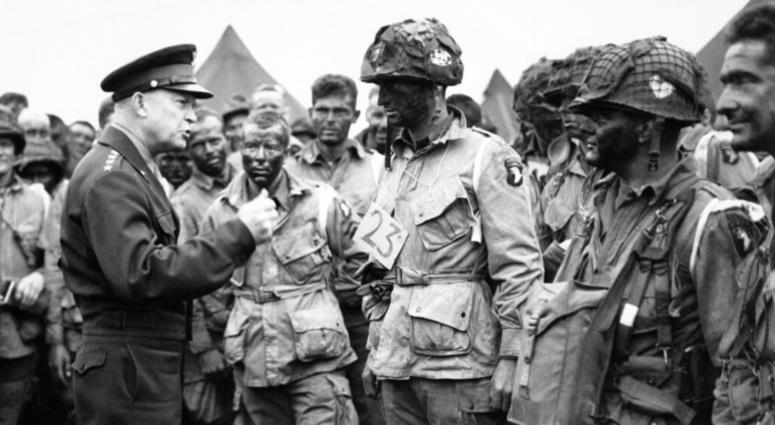 In this June 6, 1944, file photo, U.S. Gen. Dwight D. Eisenhower, left, gives the order of the day to paratroopers in England prior to boarding their planes to participate in the first assault of the Normandy invasion.