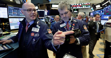 Specialist Mario Picone, left, works at his post on the floor of the New York Stock Exchange, Thursday, May 3, 2018. U.S. stocks are falling Thursday morning as the market continues a sell-off that began late the previous day.
