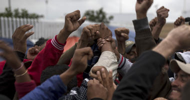 Migrants cheer and celebrate after hearing the news U.S. border inspectors allowed some of the Central American asylum-seekers to enter the country for processing, in Tijuana, Mexico, Monday, April 30, 2018,