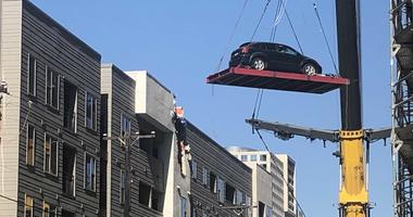 Cranes Remove Cars From Dallas Apartment Complex