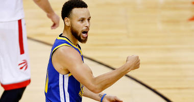 Stephen Curry celebrates as the Warriors win Game 5 of the NBA Finals.