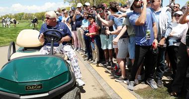John Daly drives his cart up to the 10th hole at the 2019 PGA Championship at Bethpage Black.
