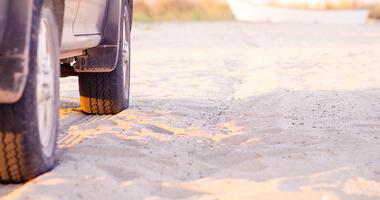 vehicle on the beach sand
