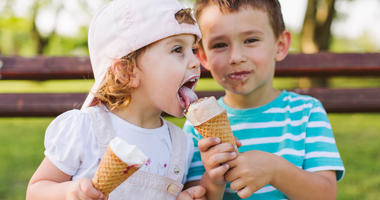 Kids Sharing Ice Cream