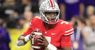 Dwayne Haskins looks to pass for Ohio State during a 2018 game.