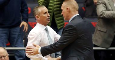 Bobby Hurley and Chris Mullin shake hands after a 2019 NCAA Tournament game between Arizona State and St. John's.