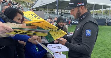 World No. 1 golfer Dustin Johnson signs autographs after a practice round at the 2019 PGA Championship at Bethpage Black in New York.