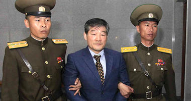 Kim Dong Chul, center, a U.S. citizen detained in North Korea