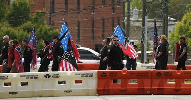 Apr 21, 2018; Newnan, GA, USA; Neo-Nazis arrive at Greenville Street Park in Downtown Newnan during the first major face off between neo-Nazis & white supremacist groups