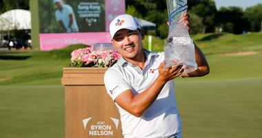 Sung Kang holds the winners trophy after winning the AT&T Byron Nelson golf tournament at Trinity Forest Golf Club
