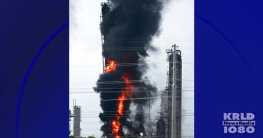 Flames and smoke rise after a fire started at an Exxon Mobil facility, Wednesday, July 31, 2019, in Baytown, Texas.