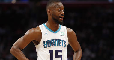 Charlotte Hornets guard Kemba Walker (15) talks to his bench during the fourth quarter against the Detroit Pistons at Little Caesars Arena.