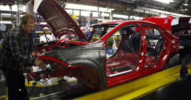 Workers assemble a preproduction Dodge Dart