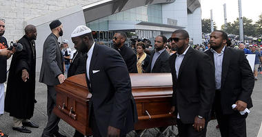 Demonstrators carrying coffins descend on AT&T Stadium to protest police shooting deaths