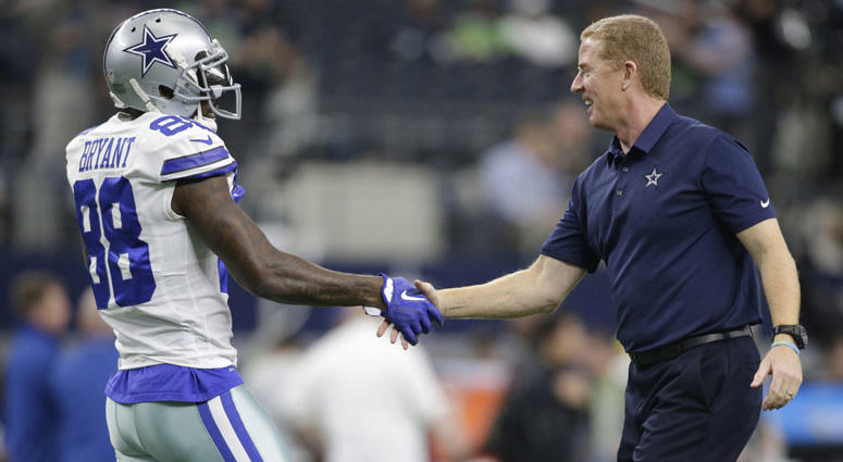 Dallas Cowboys wide receiver Dez Bryant (88) shakes hands with head coach Jason Garrett before a game