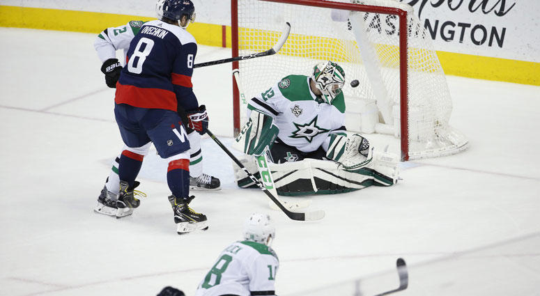 ashington Capitals defenseman John Carlson (74) scores the game winning goal past Dallas Stars goaltender Kari Lehtonen