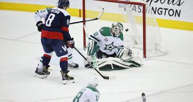ashington Capitals defenseman John Carlson (74) scores the game winning goal past Dallas Stars goaltender Kari Lehtonen