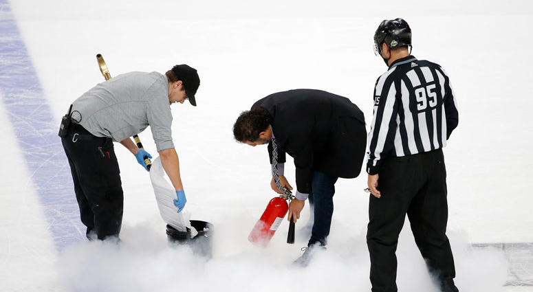 Ice maintenance crew members repair the ice during the third period in Game 1 of the NHL hockey Stanley Cup Finals between the Vegas Golden Knights and the Washington Capitals