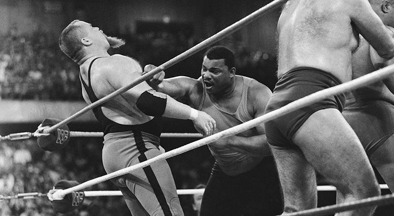 "File-This April 7, 1986, file photo shows Chicago Bears' William Perry, right, landing a punch on pro wrestler Jim ""The Anvil"" Neidhart during the ""Over-The-Top-Rope"" battle royal at Wrestlemania 2"