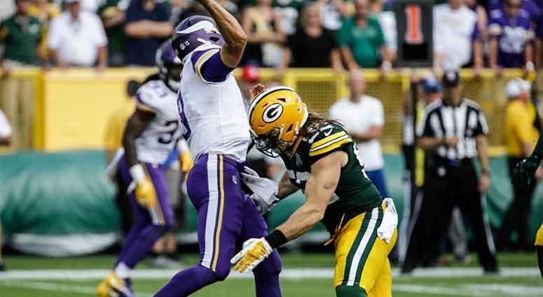 Green Bay Packers' Clay Matthews tackles Minnesota Vikings quarterback Kirk Cousins