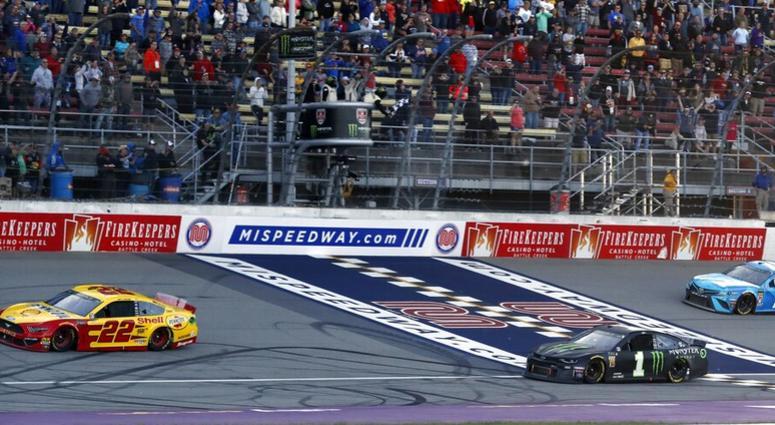 Joey Logano (22) defeats Kurt Busch (1) and Martin Truex Jr. (19) to win a NASCAR Cup Series auto race at Michigan International Speedway