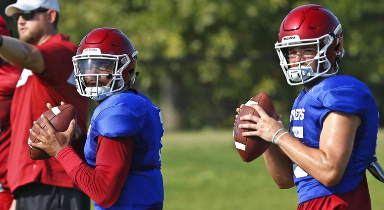 Oklahoma quarterbacks Jalen Hurts, left, and Tanner Mordecai