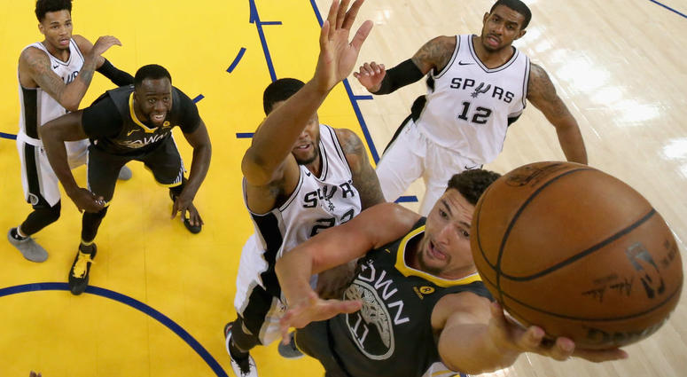 Klay Thompson #11 of the Golden State Warriors goes up for a shot against Rudy Gay #22 of the San Antonio Spurs during Game 2 of Round 1 of the 2018 NBA Playoffs at ORACLE Arena on April 16, 2018 in Oakland, California.