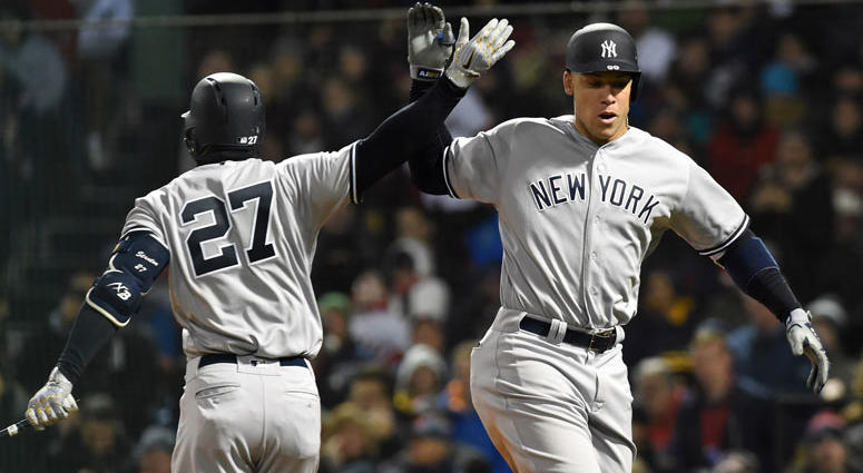 New York Yankees right fielder Aaron Judge (99) reacts with right fielder Giancarlo Stanton (27) after hitting a home run during the fifth inning against the Boston Red Sox at Fenway Park