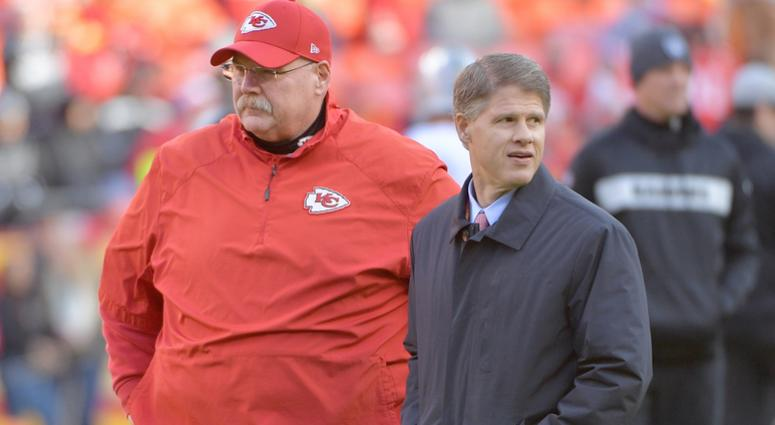 Kansas City Chiefs head coach Andy Reid (right) talks with chairman and CEO Clark Hunt